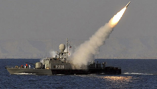 In this image made available by the Iranian Students News Agency, an Iranian navy vessel launches a missile during a drill at the sea of Oman, on Sunday, Jan. 1, 2012.