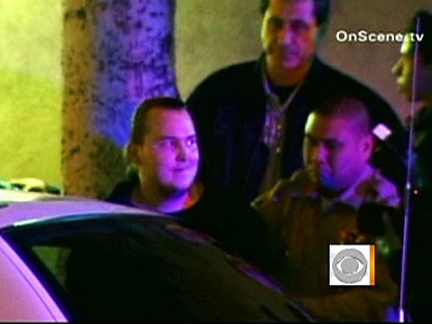 Harry Burkhart, 24, is taken into custody