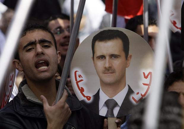 Syrian supporters of President Bashar Assad at a rally