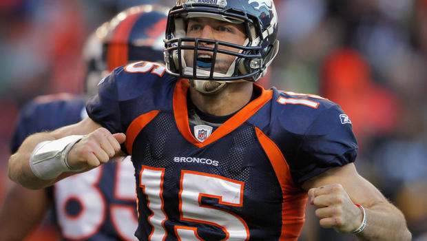 Tim Tebow celebrates his second quarter rushing touchdown