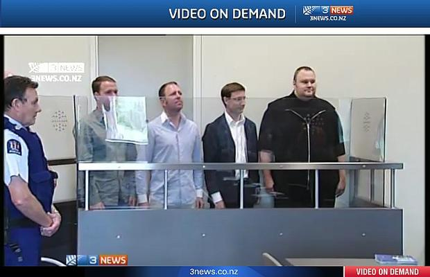 Scene from a New Zealand courtroom: Kim DotCom (at right) and others arrested January 19.
