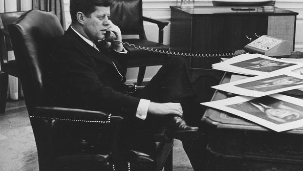 President John F. Kennedy is shown as he ends his official day after 7:30 pm with a final phone call