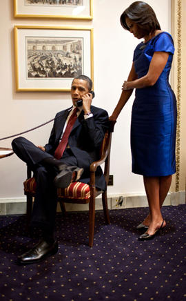 President Obama, accompanied by first lady Michelle Obama, is seen on a phone call at the Capitol in Washington Jan. 24, 2012, immediately after his State of the Union address, informing John Buchanan that his daughter Jessica was rescued by U.S. special operations forces in Somalia.