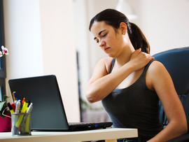 Woman Working With a Sore Back