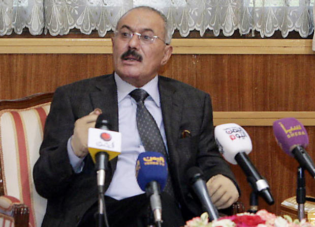 Outgoing Yemeni President Ali Abdullah Saleh speaks to the press at the presidential palace in Sanaa