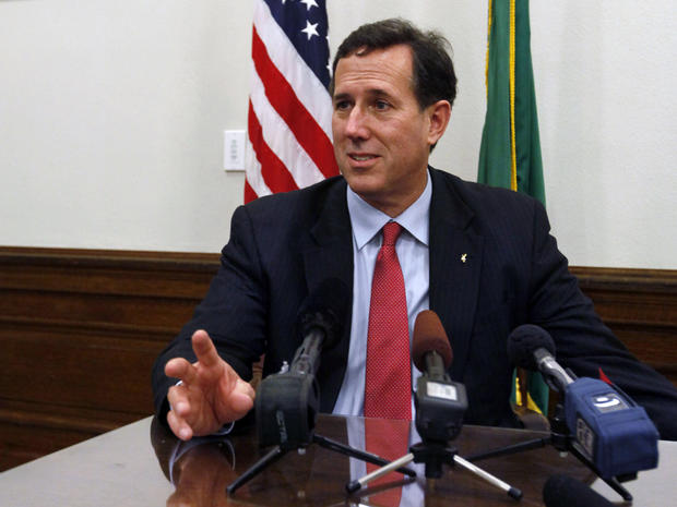Rick Santorum answers questions at a news conference in Olympia, Wash.
