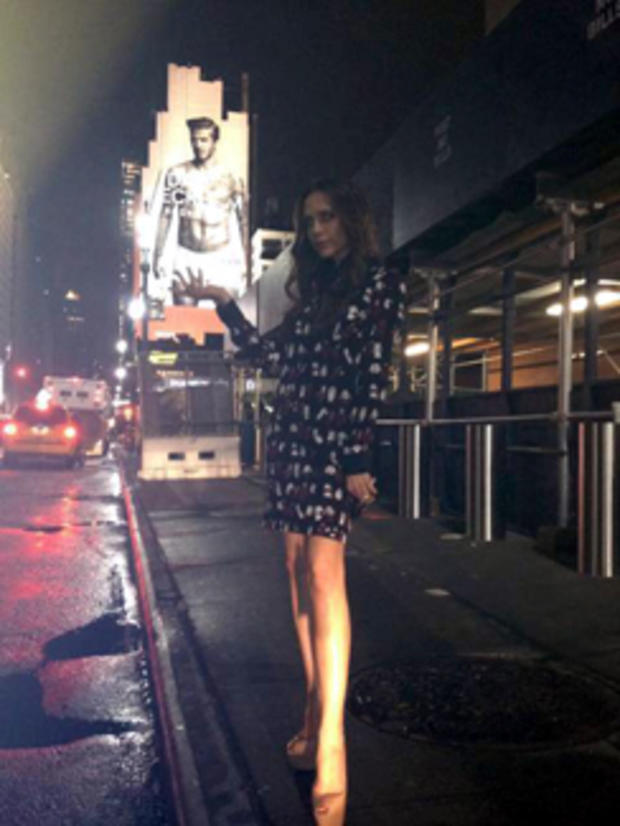 af51c1a32e7 Victoria Beckham poses with David Beckham s underwear billboard - CBS News