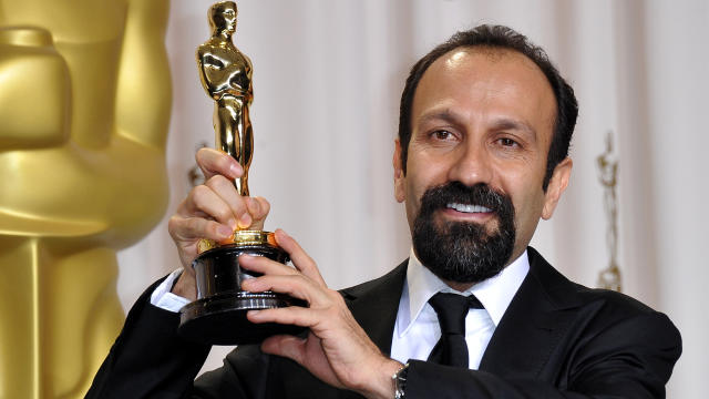 "Asghar Farhadi, director for Iran's Foreign Language entry ""A Separation,"" poses with the trophy in the press room at the 84th Annual Academy Awards Feb. 26, 2012, in Hollywood, Calif."