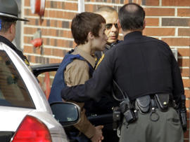 TJ Lane, a suspect in the shooting of five students at Chardon High School, is taken into juvenile court by Geauga County deputies in Chardon, Ohio, Feb. 28, 2012.