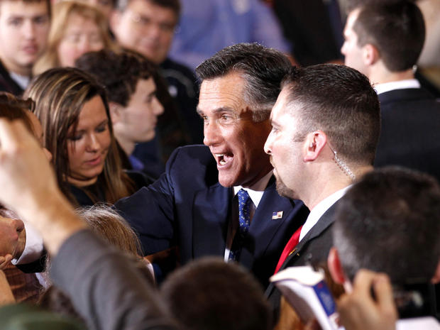 Mitt Romney greets supporters after winning the Michigan primary