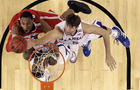 Jeff Withey battles with  Jared Sullinger
