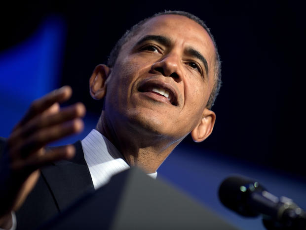 Obama blasts Romney on GOP budget plan