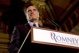 Gov. Mitt Romney pauses while speaking at a primary election night rally