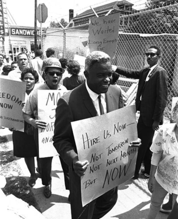 Robinson carries a placard as he joins pickets at the construction site of the Down State Medical Center in Brooklyn