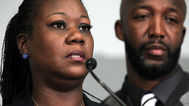 Trayvon Martin's mother, Sybrina Fulton, speaks as father Tracy Martin listens during a news conference April 11, 2012, in Washington about their son, who was fatally shot by neighborhood watch captain George Zimmerman in Florida.
