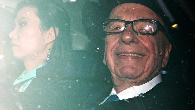 News Corp. chief Rupert Murdoch, accompanied by his wife Wendi Deng, leaves their London home April 25, 2012, to testify before Parliament.