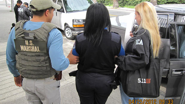 A Transportation Security Administration screener is arrested at Los Angeles International Airport in an alleged drug trafficking scheme in this picture provided by the U.S. Attorney's Office April 25, 2012.