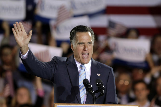 Mitt Romney takes the stage at an election night rally