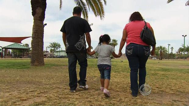 Illegal immigrants Leticia Ramirez, her husband and child in Arizona on April 25, 2012.