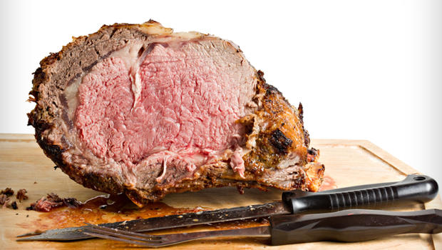 Sliced Roasted Prime Rib With Knife On Plank