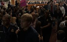 Protesters disrupt hearing with JP Morgan's Dimon