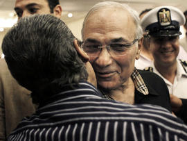 Egyptian presidential runoff candidate Ahmed Shafiq is greeted by a supporter after attending a press conference in Cairo June 8, 2012.