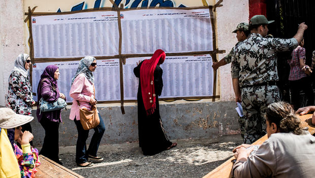 Egyptian women line up to cast their vote Saturday at polling station in Giza