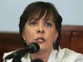 Defense attorney V'Anne Huser speaks to the media