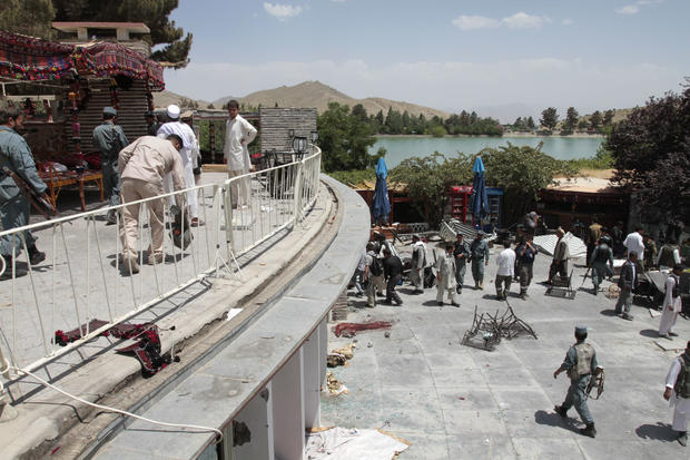 Afghan security forces and civilians are seen at the Spozhmai hotel on Lake Qurgha