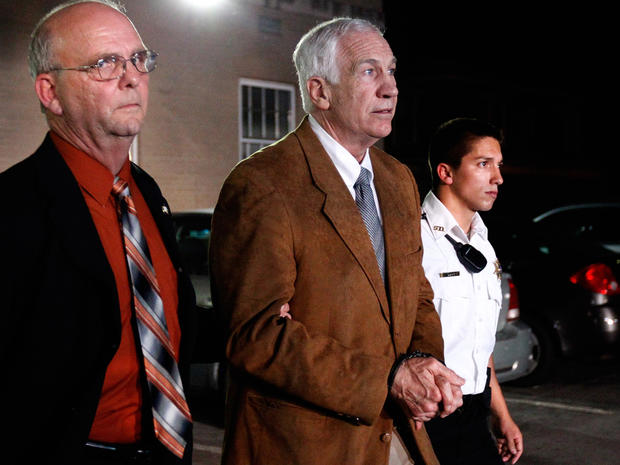 Former Penn State assistant football coach Jerry Sandusky leaves the Centre County Courthouse in handcuffs after a jury found him guilty in his sex abuse trial June 22, 2012, in Bellefonte, Pa.