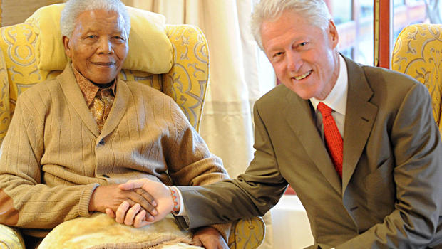 Former US President, Bill Clinton, right, meets with former South African President Nelson Mandela at his home in Qunu, South Africa, Tuesday, July 17, 2012 on the eve of Mandela's 94th birthday.