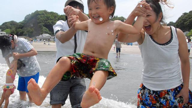 A family plays on Nakoso beach in Iwaki, Fukushima prefecture, Japan