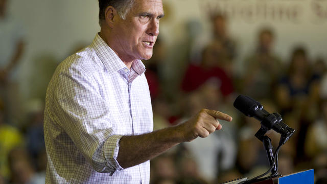 Former Massachusetts Gov. Mitt Romney gestures during a campaign event at Horizontal Wireline Services July 17, 2012, in Irwin, Pa.