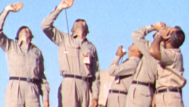 Five U.S. Air Defense Command volunteers watch nuclear test in skies over nevada desert on 7/19/57