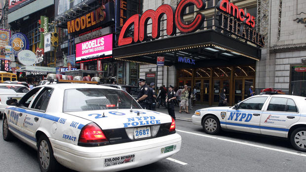 Police officers are seen outside a movie theater screening â