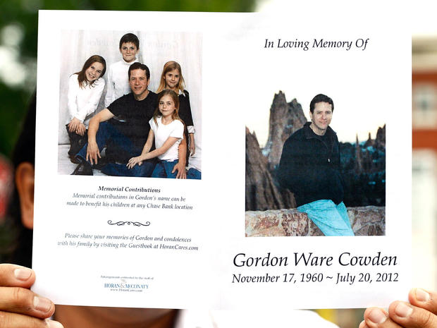 A memorial service program for movie theater shooting victim Gordon Cowden is held up, on July 25, 2012 in Denver, Colorado.