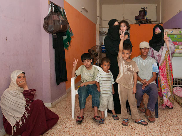 Syrian refugee Um-Khaled with her family