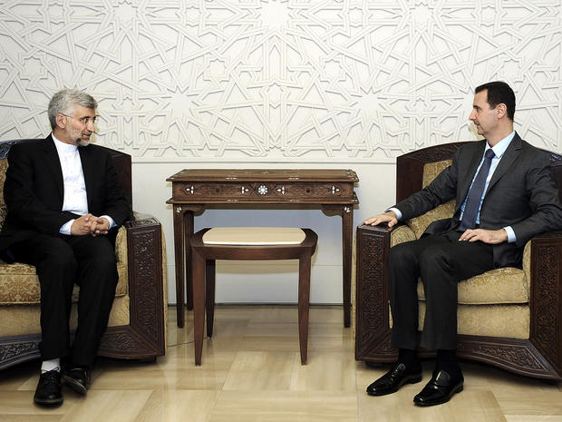 Syrian President Bashar Assad meets with senior Iranian envoy Saeed Jalili in Damascus, Syria, Aug. 7, 2012, in this photo released by the Syrian state-run news agency SANA.