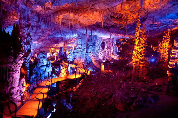 Stalactite-filled cave illuminated