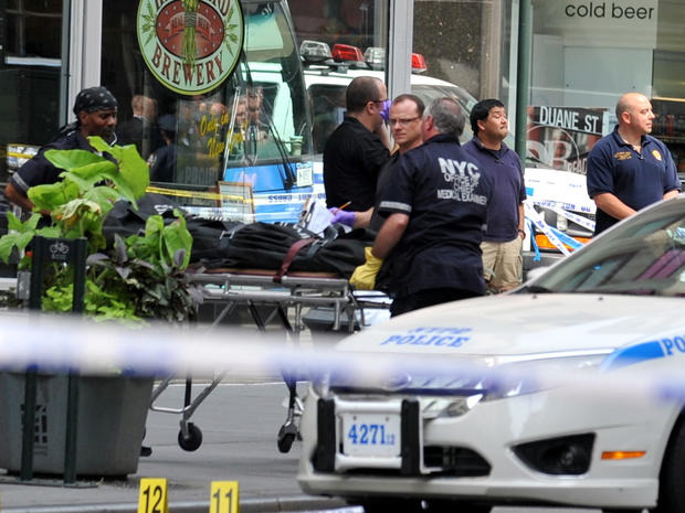 Investigators remove the body of a man who started a shootout near the Empire State Building Aug. 24, 2012, in New York.