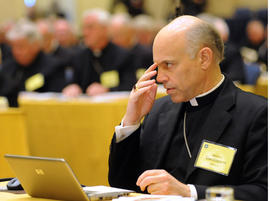 Bishop Salvatore Cordileone of Oakland, Calif. makes the sign of the cross during the fall meeting of the U.S. Conference of Catholic Bishops Monday, Nov. 15, 2010 in Baltimore.