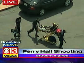 A patient is seen on a stretcher after a shooting at Perry Hall High School in Perry Hall, Md., Aug. 27, 2012.