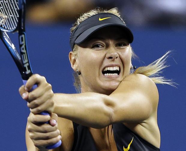 Maria Sharapova returns a shot to Lourdes Dominguez Lino