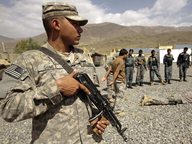 U.S. soldier stands guard during a training session for Afghan National Police
