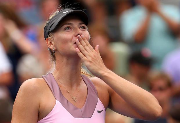 Maria Sharapova of Russia reacts after defeating Marion Bartoli
