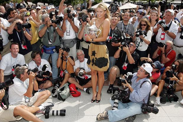 Maria Sharapova poses with women's U.S. Open championship trophy