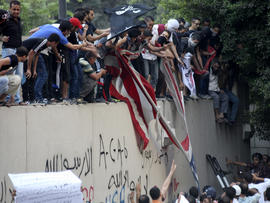 Protesters destroy an American flag pulled down from the U.S. Embassy in Cairo Sept. 11, 2012.