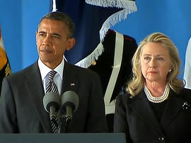 President Obama and Secretary of State Hillary Clinton pause for a moment of silence in Andrews Air Force Base, Md., Sept. 14, 2012.