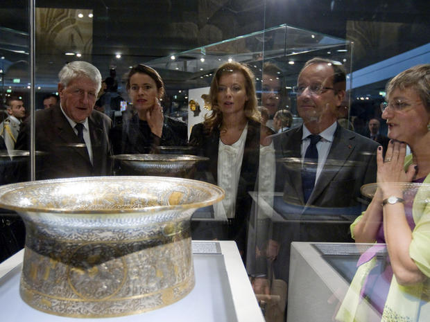 French President Francois Hollande looks at the Saint Louis baptistery