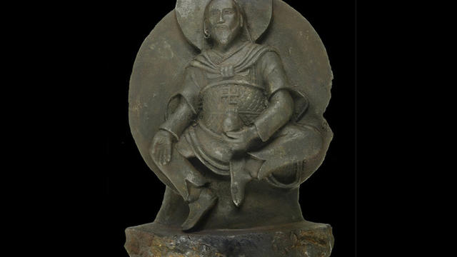 A Buddha statue dating back to the 8th to 10th centuries is carved from a rare iron meteorite.